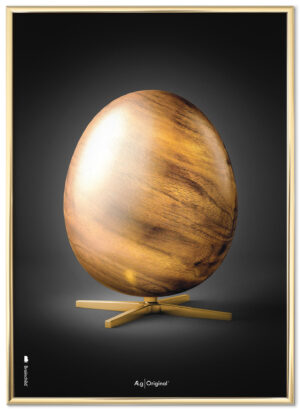 Brainchild poster with wooden egg, black background, framed in gold poster frame